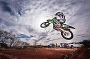 Motocross racer Justin Berry flies through the air during a practice session in Edmond, Oklahoma