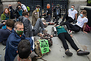 Climate activists from Extinction Rebellion, some of whom glued to the pavement, blockade the Houses of Parliament on 3 September 2020 in London, United Kingdom. Extinction Rebellion activists are attending a series of September Rebellion protests around the UK to call on politicians to back the Climate and Ecological Emergency Bill CEE Bill which requires, among other measures, a serious plan to deal with the UK's share of emissions and to halt critical rises in global temperatures and for ordinary people to be involved in future environmental planning by means of a Citizens' Assembly.