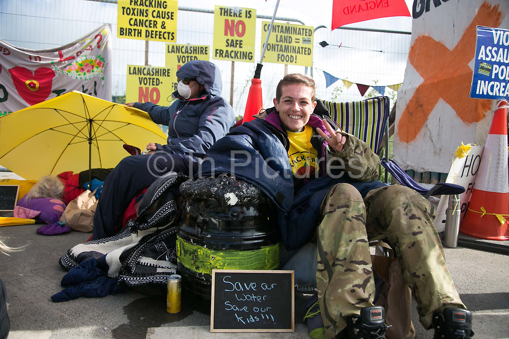 12 local activists locked themselves in specially made arm tubes to block the entrance to Quadrillas drill site in New Preston Road, July 03 2017, Lancashire, United Kingdom. Jeanette Porter. The 13 activists included 3 councillors; Julie Brickles, Miranda Cox and Gina Dowding and Nick Danby, Martin Porter, Jeanette Porter,  Michelle Martin, Louise Robinson,<br /> Alana McCullough, Nick Sheldrick, Cath Robinson, Barbara Cookson, Dan Huxley-Blyth. The blockade is a repsonse to the emmidiate drilling for shale gas, fracking, by the fracking company Quadrilla. Lancashire voted against permitting fracking but was over ruled by the conservative central Government. All the activists have been active in the struggle against fracking for years but this is their first direct action of peacefull protesting. Fracking is a highly contested way of extracting gas, it is risky to extract and damaging to the environment and is banned in parts of Europe . Lancashire has in the past experienced earth quakes blamed on fracking.