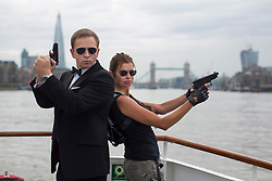 © licensed to London News Pictures. London, UK 22/08/2013. City Cruises launching their new Thamesjet, jet powered RIB, speedboat ride service with Angelina Jolie and Daniel Craig lookalikes on Thursday, 22 August 2013 in central London. Photo credit: Tolga Akmen/LNP