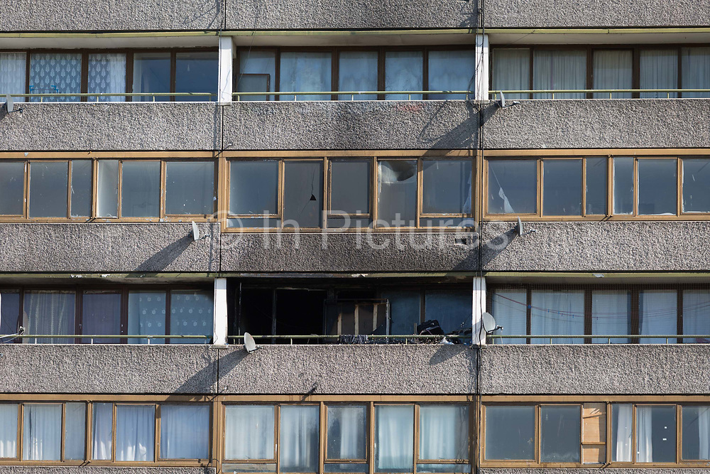 Smoke damage aftermath on the exterior of a flat fire in one of the two Wendover blocks on Alsace Road on the Aylesbury Estate, Southwark SE17, on 24th September 2018, in London, England. Part of a split level flat on the fourth and fifth floor of the 15-storey block was damaged. One woman and two children left the property before the Brigade arrived. They were treated at the scene for smoke inhalation by London Ambulance Service crews and taken too hospital. Another man was also treated at the scene for smoke inhalation.