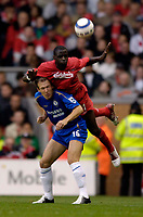Photo: Jed Wee.<br /> Liverpool v Chelsea. The Barclays Premiership.<br /> 02/10/2005.<br /> <br /> Liverpool's Djimi Traore (R) climbs on the back of Chelsea's Arjen Robben.