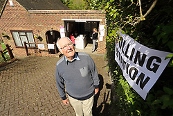 ©Licensed to London News Pictures 07/05/2015  London, UK.  Garage Polling Station, Fairdene Road in Coulsdon South London. Allowing a more convenient way of voting so voters don't have to go into town. Pictured Tony Lloyd house owner Photo credit: Presspics/LNP