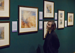Pictured: Jill Brown from the Scottish National Galleriesgets up close and personal to waterciolour and gouache painting of Heildeburg<br /> The annual exhibition of the collection of Turner watercolours bequeathed in 1900 by Henry Vaughan was in the final stages of preparation today.  The exhibition runs at the Scottish National Gallery from January 1 to 30<br /> <br /> <br /> Ger Harley | EEm 21 December 2017