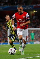27.08.2013, Emirates Stadion, London, ENG, UEFA CL Qualifikation, FC Arsenal vs Fenerbahce Istanbul, Rueckspiel, im Bild Arsenal's Kieran Gibbs runs with the ball during the UEFA Champions League Qualifier second leg match between FC Arsenal and Fenerbahce Istanbul at the Emirates Stadium, United Kingdom on 2013/08/27. EXPA Pictures © 2013, PhotoCredit: EXPA/ Mitchell Gunn<br /> <br /> ***** ATTENTION - OUT OF GBR *****