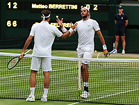 Tennis - 2019 Wimbledon Championships - Week Two, Monday (Day Seven)<br /> <br /> Men's Singles, Fourth Round: Roger Federer (SUI) v Matteo Berrettini (ITA)<br /> <br /> Roger Federer shakes hands with Matteo at the net after the match on Centre court <br /> <br /> COLORSPORT/ANDREW COWIE
