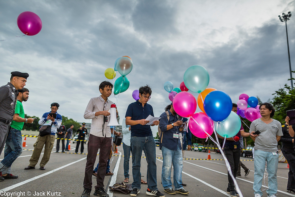 """24 JUNE 2014 - BANGKOK, THAILAND: Members of the """"Monsoon Poets Society"""" read their poems in front of the Anantasamakom Throne Hall Tuesday during an event to pay homage to the People's Party, a Siamese (Thai) group of military and civil officers (which became a political party) that staged a bloodless coup against King Prajadhipok (Rama VII) and changed Thailand (then Siam) from an absolute monarchy to a constitutional monarchy on 24 June 1932. Since the coup against the civilian government on 22 May, the ruling junta has not allowed political gatherings. Although police read the poems, they did not arrest any of the poets or make any effort to break up the gathering.     PHOTO BY JACK KURTZ"""