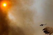 May 15, 2014 - Escondido, California, U.S -<br /> <br /> California Wildfires 2014 - Cocos Fire<br /> <br /> The third day of multiple fires proved difficult for fire agencies as they battled a variety of fires across San Diego County. A fire fighting helicopter turns away from flames after dropping 2000 gallons of water on a fire that was at the border of Camp Pendleton and Fallbrook.<br /> ©Exclusivepix
