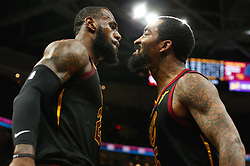 April 25, 2018 - Cleveland, OH, USA - The Cleveland Cavaliers' LeBron James, left, celebrates a basket and foul with teammate JR Smith in the third quarter against the Indiana Pacers in Game 5 on Wednesday, April 25, 2018, at Quicken Loans Arena in Cleveland. The Cleveland Cavaliers won, 98-95, for a 3-2 lead in the first-round NBA playoff series. (Credit Image: © Leah Klafczynski/TNS via ZUMA Wire)