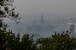 © Licensed to London New. Views from Richmond Park towards South West London and Surrey. As weather forecasts predict a wet weekend before the clocks go back on Sunday. Photo credit: Alex Lentati/LNP