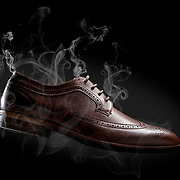 A classic mens shoes with smoke surrounding it. Photographed in the Hype Photography studio, Basingstoke Hampshire