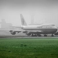 Nederland, Amsterdam , 18 november 2011..Vanwege zware mist op luchthaven Schiphol konden diverse toestellen niet opstijgen,.Foto:Jean-Pierre Jans