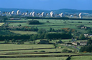 A view of the green Yorkshire moors countryside looking down from a nearby hill to the top secret intelligence-gathering base of RAF Menwith Hill, near Harrogate, Yorkshire, England. One sees the surreal-looking white radomes in the shape of golf balls - each containing a satellite dish - that are dotted across the science-fiction landscape. Many of these are used for signals interception from communications satellites and are commonly thought to be part of ECHELON, a highly secretive world-wide signals intelligence and analysis network. Other parts of this notorious  site are thought to be used by the Space Based Infrared System employed by the US National Missile Defence program. The base has attracted significant levels of protest from anti-nuclear and pacifist groups.