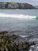 Waves crash on the rocks at Jacks Bay, Otago, South Island, New Zealand.