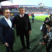 Trabzonspor's coach Kazim Ersun Yanal (L) and Galatasaray's Coach Hamza Hamzaoglu (R) during their Turkish SuperLeague Derby match Trabzonspor between Galatasaray at the Avni Aker Stadium at Trabzon Turkey on Sunday, 19 April 2015. Photo by TVPN/TURKPIX
