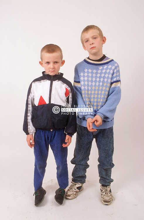 Studio portrait of two young boys looking serious,