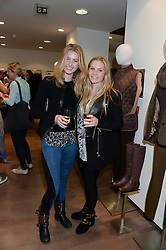 Left to right, ELLA MAY SANGSTER and GIGI BACON at a preview evening of the Leon Max Autumn Winter Collection 2013 held at Leon Max, 229 Westbourne Grove, London W11 on 24th September 2013.