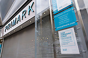 Primark has had to close it's doors again on the day that the second national lockdown came into effect in the city centre as all non-essential shops are closed while others remain trading on 5th November 2020 in Birmingham, United Kingdom. The new national lockdown is a huge blow to the economy and for individual businesses who were already struggling with only offering limited services.