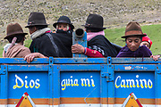 Quichua Indians on truck<br /> Going to a minga<br /> Chimborazo Province<br /> Andes<br /> ECUADOR, South America