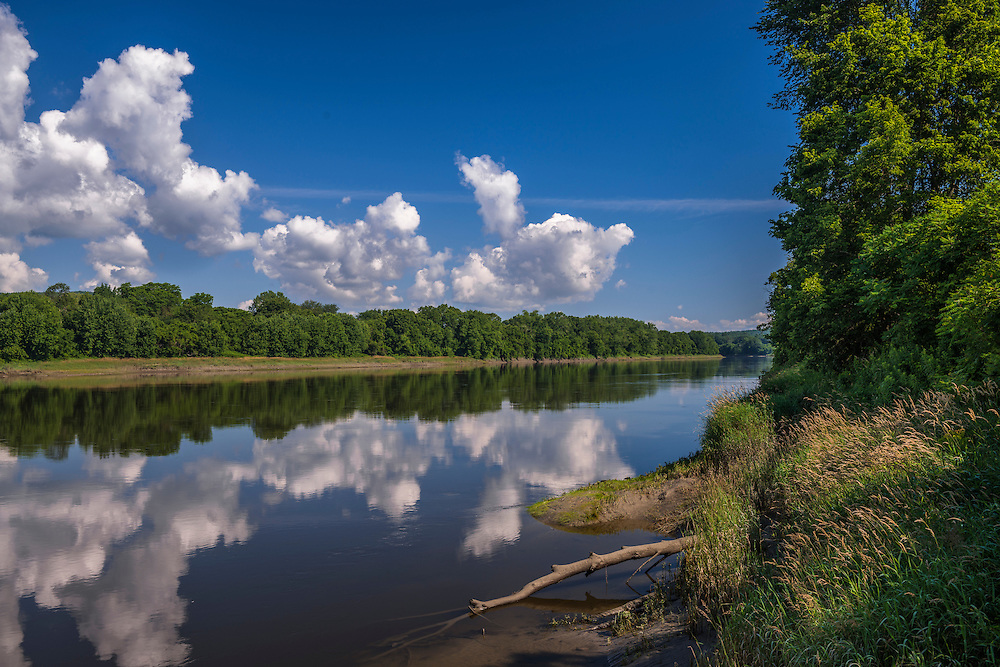 Connecticut river in early summer, still water with reflections, Cornish, NH