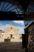 A small church in the medieval, hilltop town of Monteriggioni in Tuscany, Italy