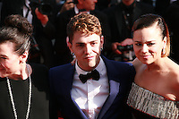 Anne Dorval. director Xavier Dolan and Suzanne Clement at the Palme d'Or  Closing Awards Ceremony red carpet at the 67th Cannes Film Festival France. Saturday 24th May 2014 in Cannes Film Festival, France.