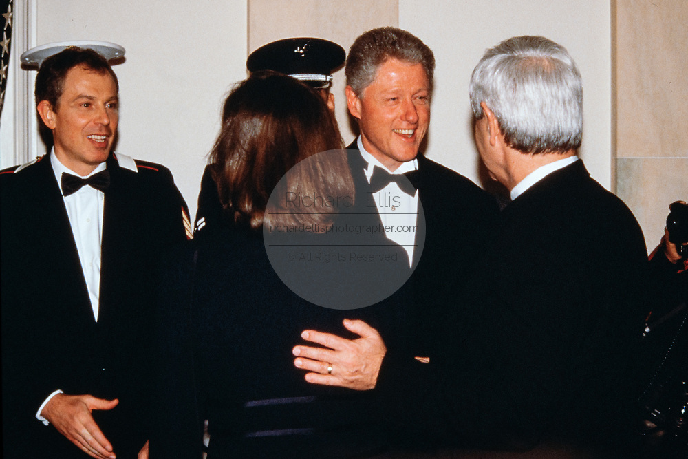 U.S. President Bill Clinton, center, and British Prime Minister Tony Blair, left, welcome Speaker Newt Gingrich, right, and his wife Marianne Ginther in the receiving line during the State Dinner at the White House February 5, 1998 in Washington, DC.