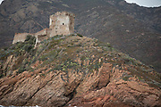 Genoese tower watching over Girolata village on 15th September 2017 in Corsica, France. Girolata is a village and region at the south of the Scandola Nature Reserve in western Corsica, about 35 km north-west from Porto. It falls within the western part of the Corsica Natural Park. It is quite inaccessible. The Scandola Nature Reserve is located on the west coast of the Corsica, within the Corsica Regional Park. The reserve was established in 1975 and has been recognized by the United Nations as a Natural World Heritage Site, and was inscribed on the World Heritage List in 1983.