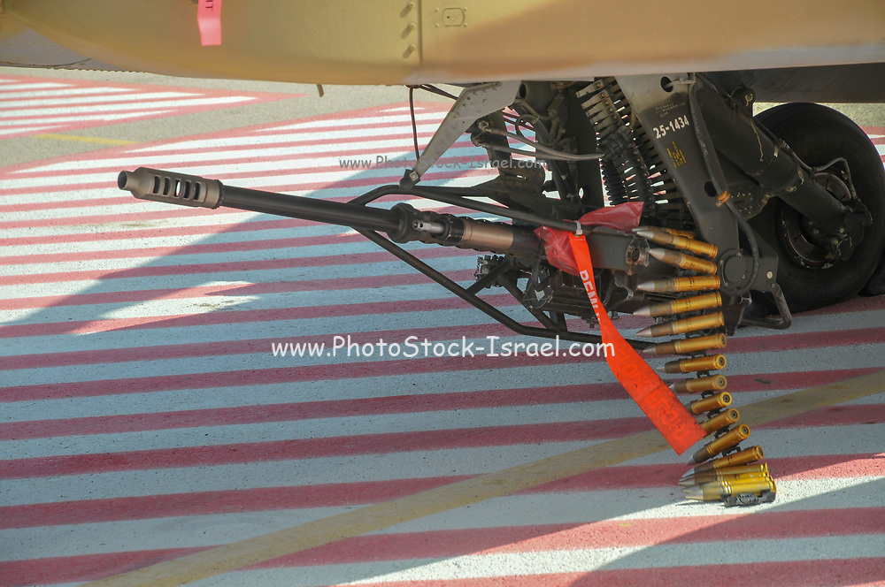 An Israeli Air force (IAF) exhibition. IAF Boeing Apache AH-64A (Peten) Helicopter on the ground. Close up of the armaments
