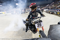 Hooligan Dave Kilkenny does a burnout on his 1993 HD Sportster at the Flat Out Friday flat track racing on the Dr. Pepper-covered track in the UW-Milwaukee Panther Arena during the Harley-Davidson 115th Anniversary Celebration event. Milwaukee, WI. USA. Friday August 31, 2018. Photography ©2018 Michael Lichter.