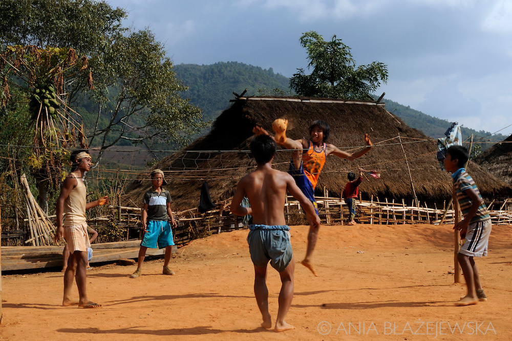 Burma/Myanmar. Akha boys playing chinlon - very popular game in the country.