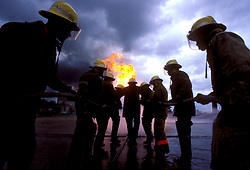 Stock photo of Houston fire fighters training with the fire hoses