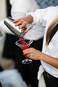 Bartender Making A Red Martini