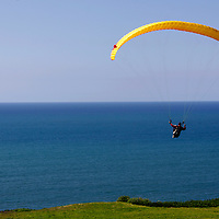 USA, California, San Diego. Torrey Pines Paraglider after launch.