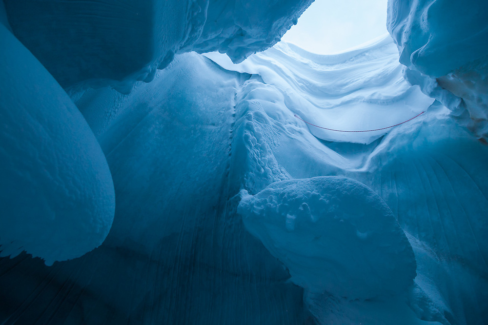 Inside the entrance to an ice cave in Scott Turnerbreen, Svalbard.