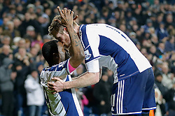 Brown Ideye of West Brom is kissed on the head by Chris Brunt as he celebrates scoring a goal to make it 1-0 - Photo mandatory by-line: Rogan Thomson/JMP - 07966 386802 - 11/02/2015 - SPORT - FOOTBALL - West Bromwich, England - The Hawthorns - West Bromwich Albion v Swansea City - Barclays Premier League.