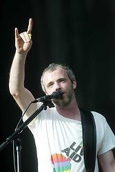 Fran Healy, lead vocalist of the Scottish band Travis, plays his banjo on the main stage on Sunday 10th July, 2005 at the two-day T in the Park festival, at Balado, Kinross-shire, Scotland..