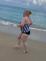 "EXCLUSIVE: Mama June jogs on a beach in a swimsuit as she ramps up her weight loss campaign. The reality star, 40, is determined to lose 45lbs and has been doing yoga sessions and long walks to try and meet her weight goal. The mother-of-four was pictured at Jensen Beach, Florida where she showed off her new keep fit plan. A friend, who revealed June has lost 20lbs so far, said: ""June has really been focusing on her fitness to try and shed some of the pounds she put on. She's been doing a lot of yoga and jogging in the mornings on the beach. ""She has been training everyday with her close friend artist Adam Barta."" June once weighed 460lbs but lost a staggering 300lbs after an intense exercise regime coupled with gastric and plastic surgery. Since tipping the scales at 160lbs she has now put on some extra weight and is bidding to lose an extra 45lbs. She is pictured wearing a swimsuit gifted to her by Dominique's surf shop in Florida. 02 Jun 2020 Pictured: Mama June jogs on a beach in a swimsuit as she ramps up her weight loss campaign. Photo credit: MEGA TheMegaAgency.com +1 888 505 6342"