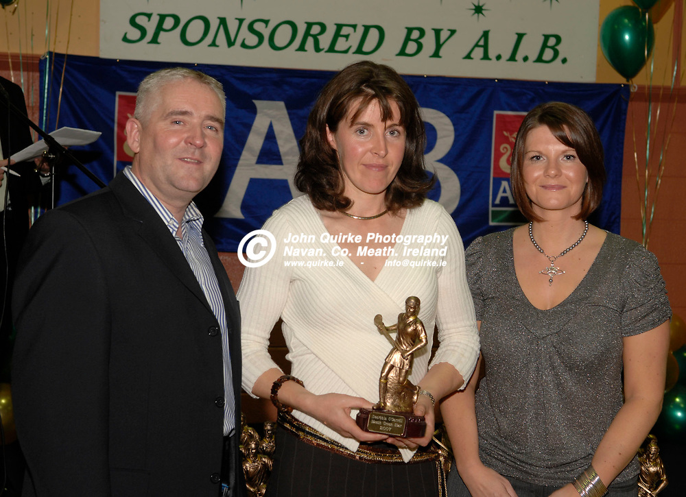 30-11-07. Meath Green Stars Banquet at Simonstown.<br /> Cormac Farrell, O'Neills and Debbie Breen, AIB presenting a Meath Camogie Green Star Award to Dearbhia O'Carroll, Trim.<br /> Photo: John Quirke / www.quirke.ie<br /> ©John Quirke Photography, Unit 17, Blackcastle Shopping Cte.<br /> Navan. Co. Meath. 046-9079044 / 087-2579454.