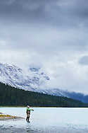Fly fishing at Waterfowl Lake in Banf National Park, Canada.