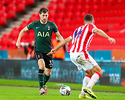 Ben Davies of Tottenham Hotspur is challenged by Tommy Smith of Stoke City  - Mandatory by-line: Nick Browning/JMP - 23/12/2020 - FOOTBALL - Bet365 Stadium - Stoke-on-Trent, England - Stoke City v Tottenham Hotspur - Carabao Cup