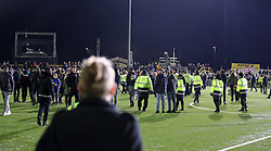 Fans on the pitch after the Emirates FA Cup, Fifth Round match at Gander Green Lane, London.