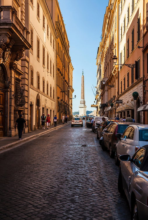 A view down a street in Rome, Italy towards the Spanish Steps and Obelisk Sallustiano.