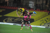 Football - 2020 / 2021 Sky Bet Championship - Watford vs Derby County - Vicarage Road<br /> <br /> William Troost - Ekong of Watford flies over the top of Colin Kazim - Richards of Derby<br /> <br /> Credit : COLORSPORT/ANDREW COWIE