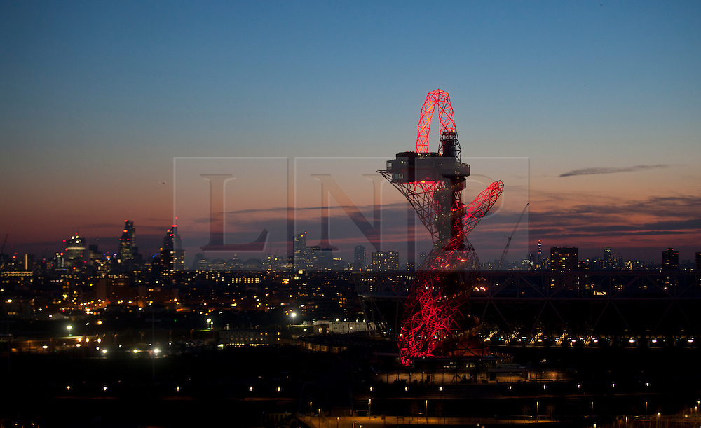 © Licensed to London News Pictures . 03/03/2014. London, UK.  The ArcelorMittal Orbit stands out as the night falls over the city of London. The tower will be open for visitors from 5 April this year (05/04/2014) Photo credit: Isabel Infantes /LNP