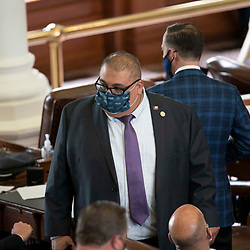 Austin, TX USA March 31, 2021:  State Rep. Ryan Guillen, D-Rio Grande City, on the floor of the Texas House of Representatives during routine bill readings at the 87th Texas legislative session. Emergency bills include power company regulation, border security and the coronavirus response.