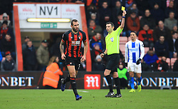 Bournemouth's Steve Cook (left) receives a yellow card from referee Michael Oliver during the Emirates FA Cup, third round match at the Vitality Stadium, Bournemouth.
