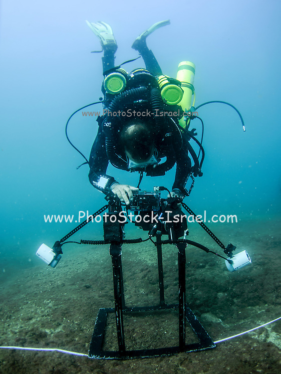 professional Scuba diver perform an underwater survey of the Mediterranean seabed