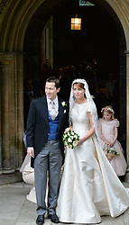 The bride & groom Thomas Hooper and the Hon.Alexandra Knatchbull at the wedding of the Hon.Alexandra Knatchbull to Thomas Hooper held at Romsey Abbey, Romsey, Hampshire on 25th June 2016