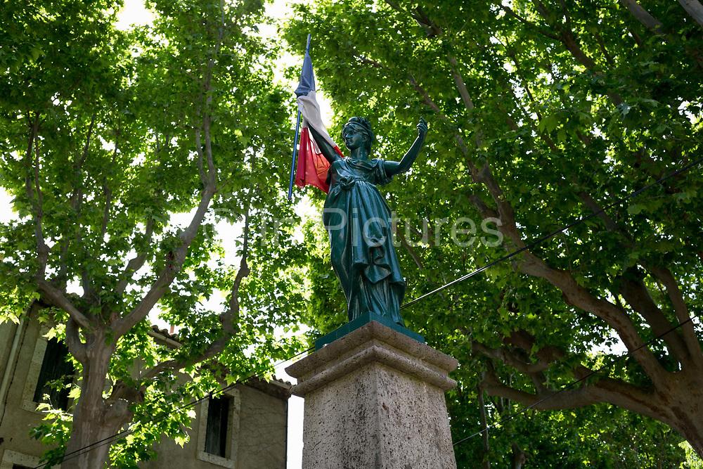 Patriotic war memorial in Place de la Republique, on 21st May 2017, in Fabrezan, Languedoc-Rousillon, south of France.